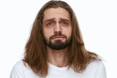 Tired Man With Exhausted Face And Dark Circles Under Eyes. And Long Hair On White Background. High Resolution Stock Images