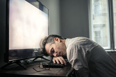 Tired man. Exhausted man falling asleep in the office Stock Photos