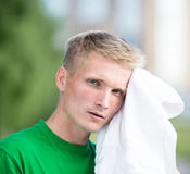 Tired man after fitness time and exercising. With white towel Stock Photos