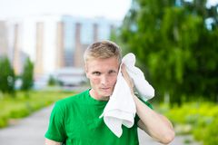 Tired man after fitness time and exercising. With Stock Photo