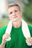 Tired man after fitness time and exercising. With Stock Images