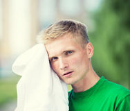 Tired man after fitness time and exercising. With Royalty Free Stock Images