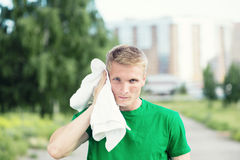 Tired man after fitness time and exercising. With Royalty Free Stock Photography