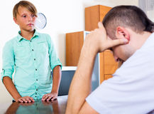 Tired man and frustrated teenager Royalty Free Stock Image