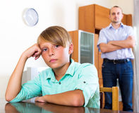 Tired man and frustrated teenager Royalty Free Stock Photo