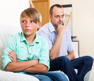 Tired man and frustrated teenager Stock Photos