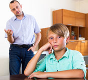 Tired man and frustrated teenager Stock Photo