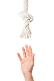 Tired man hand pulling to helping rope royalty free stock images