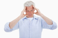 Tired man having a headache Stock Photo