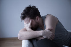 Tired man with headache. Image of tired man with hedache after sleepless night Royalty Free Stock Image