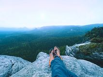 Tired man hiker lay down and enjoy view into landscape over his tired legs in tourist boots Stock Photos