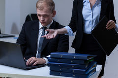 Tired man and his female boss Stock Photos