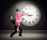 Tired man holding angry woman Stock Photography