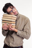 Tired man holding books and sleeping Stock Photography