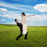 Tired man holding screaming woman. Tired men holding screaming angry women and going forward. photo at outdoor Stock Photography