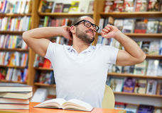 Tired man in the library Stock Images