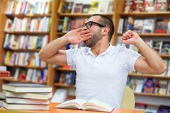 Tired man in the library Royalty Free Stock Photos