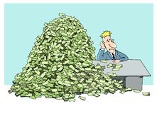 Tired man and  mountain of money Royalty Free Stock Photo