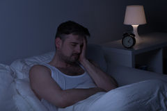 Tired man needs some sleep. Tired man with insomnia needs some sleep Stock Image