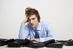Tired man in the office Royalty Free Stock Photography