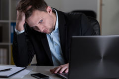 Tired man in office Stock Image