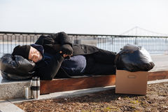 Tired man putting his head on the garbage bag Stock Photo