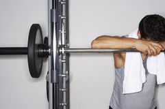 Tired Man Resting On Barbell At Gym Stock Image