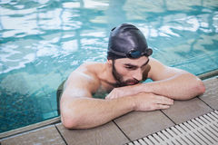 Tired man resting. At the edge of the pool Royalty Free Stock Photography