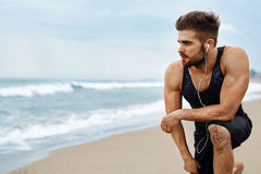 Tired Man Resting After Running On Beach. Sports Workout Outdoor Royalty Free Stock Photos