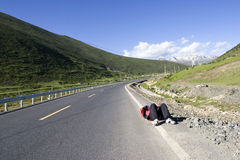 Tired man on road. A man lie on a road in nature because of tired Royalty Free Stock Photography