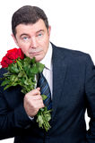 Tired man with roses waiting Royalty Free Stock Image