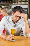 Tired man sitting in a bar Royalty Free Stock Photos