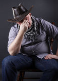 Tired man sitting on a chair Royalty Free Stock Photos