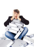 Tired man is sitting with many paper folders isolated on white b Stock Photo
