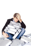 Tired man is sitting with many paper folders isolated on white b Stock Images