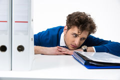 Tired man sitting at the office Royalty Free Stock Photos