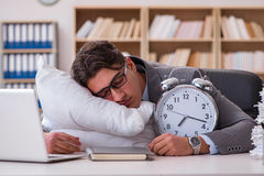 The tired man sleeping at home having too much work. Tired man sleeping at home having too much work Stock Images