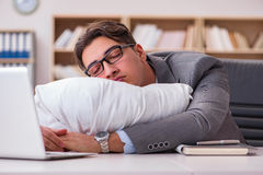 The tired man sleeping at home having too much work. Tired man sleeping at home having too much work Royalty Free Stock Photography
