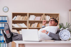 The tired man sleeping at home having too much work. Tired man sleeping at home having too much work Royalty Free Stock Photos