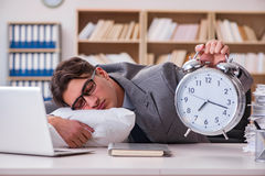 The tired man sleeping at home having too much work. Tired man sleeping at home having too much work Stock Photo