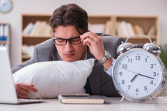 The tired man sleeping at home having too much work. Tired man sleeping at home having too much work Royalty Free Stock Images