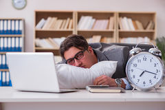 The tired man sleeping at home having too much work. Tired man sleeping at home having too much work Stock Photos