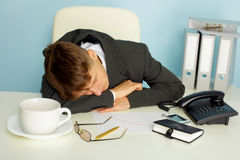 Tired man sleeping on a table Royalty Free Stock Photography