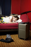 Tired man sleeping uncomfortably. Young man sleeping uncomfortably in bed Royalty Free Stock Photography
