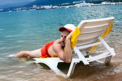 Tired man by the sun on vacation royalty free stock images