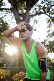 Tired man taking a break while jogging Stock Image