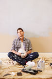 Tired Man Taking A Break Whilst Decorating Room Royalty Free Stock Photo