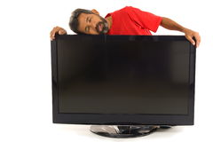 Tired man and the Tv Royalty Free Stock Photography