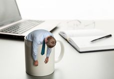 Tired man in white cup Royalty Free Stock Photo