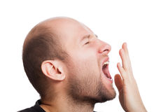 Tired man wide open mouth yawning Stock Photo